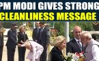 PM Modi picks up flowers fallen on the carpet at Houston airport, video goes viral