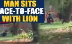Man jumps inside Lion's Enclosure, sits face to face with lion, video goes viral