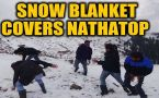 Tourists enjoy early snowfall in Nathatop, J&K