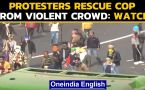 Tractor Rally: Video shows protesters rescuing the cop from a violent mob: Watch