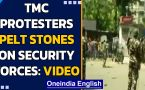 TMC supporters protest outside Governor's residence, pelt stones