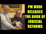PM Modi presents the 1st copy of Judicial reformsRecent Global Trends to President Mukherjee