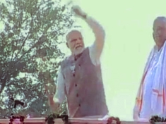 PM Modi plays traditional drum during rally in Rajasthan