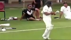 Fawad Ahmed Khan walks onto the ground with two gloves of same hand