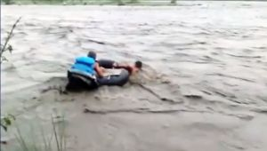 NDRF personnel rescue people stranded in flooded river