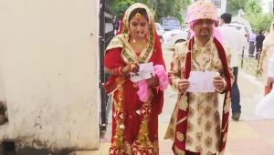 Lok Sabha Elections 2019: Newly-married couple turn up for voting in J&K's Udhampur