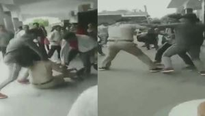 GRP official thrashed by two youths in UP's Deoria  Viral Video