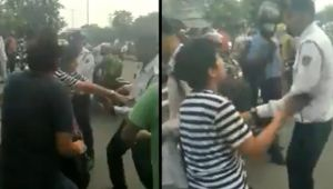 Delhi Woman Hits Cop when stopped for riding without Helmet, video viral