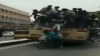 Watch college students fall off moving bus while celebrating 'bus day'