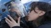 Italy: Woman protester charged for 'sexual assault' for 'kissing' cop