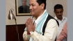 Action on arrested officials after studying report: Sonowal