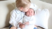 First cute pics of British royal babies released; Big brother kisses little sister