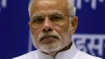Narendra Modi faces ire over price rise; Congress workers deface hoarding depicting PM