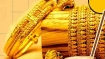 Gold prices hit six-week low as dollar firms on robust U.S. data