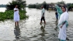 Unlike Modi, Nitish, Mamata gives a skip to aerial survey, wades through floodwaters in WB