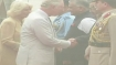 Prince Charles and wife Camilla arrive in smog covered Delhi