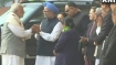 After war of words, PM Modi shakes hands with Manmohan Singh