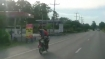 This man is flying on his motorcycle; never try this