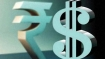 Rupee gains 20 paise to 69.75 against dollar in opening trade