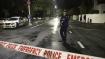 Barefoot, handcuffed, New Zealand shooter smirks in court