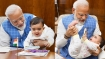 Revealed: The child in Modi's arms, who he called a special friend in Parliament
