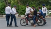 Stopped for not wearing helmet, rider told to cough upto Rs 25,000 fine
