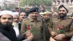 Want peace: Locals in Delhi's Jama Masjid area offer roses to police amid anti-CAA protests