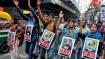 TMC women members in Kolkata sport mehendi with no 'CAA' , 'NRC' slogan