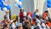 Suit up junior! AAP invites 'baby mufflerman' to Kejriwal's swearing in ceremony
