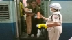 Motherly touch by police woman calms baby on train