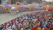 Kumbh Mela: Thousands of devotees flout COVID-19 norms, take holy dip in Ganga on Shahi Snan as virus surges