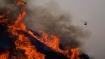California wildfire advances as heatwave blankets US West