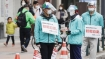 Japan's coronavirus infections surge to record highs