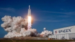 Falcon Heavy rocket soars towards sky with 24 research satellites