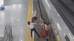 Woman tries to stop high-speed train by sticking her foot in the platform gap