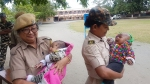 This pic of Assam cops holding babies while their mom write TET exam, wins internet