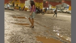 A unique way to highlight potholes in B'luru: Turn them into photo ops and embarrass the authorities