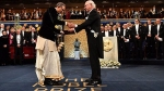 Abhijit Banerjee, wife Duflo draped in Dhoti and Sari receive medals of Nobel Prize