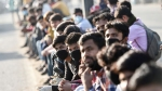 Amid COVID-19 risk, thousands of migrant workers throng Delhi bus station, wait for ride home