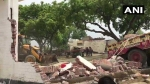 Bulldozer mows down history sheeter Vikas Dubey's house, police find underground bunker