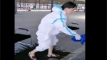 Watch: COVID-19 nurse pours out bucket of sweat from her PPE kit China