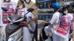 West Bengal CM Mamata Banerjee rides pillion on electric scooter to protest fuel price hike