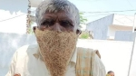 Cannot afford a mask: Man sports bird's nest to collect pension at govt office