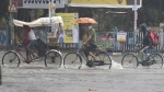 Rains lash several parts of T'gana, IMD issues red alert to 14 districts; Schools, colleges to remain closed