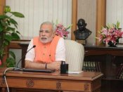 Narendra Modi adopts Mahatma's vision; promotes spinning wheel to empower women