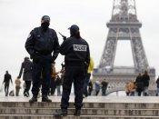 Eiffel Tower goes dark as France mourns 129 dead