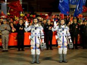 Chinese astronauts dock with space lab