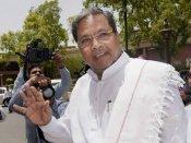 Explain IT raids in Bengaluru- A united opposition asks Congress