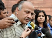 Delhi: Sisodia faces protest while flagging off new buses