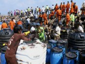 Why is Chennai oil spill being cleaned manually?